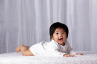 Chinese baby on tummy smiling - Yukmin