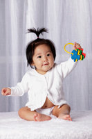 Young baby holding toy keys - Yukmin