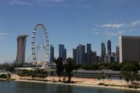 Skyline of Singapore with the Singapore Flyer - Yukmin