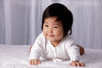 Chinese baby on tummy, smiling - Yukmin