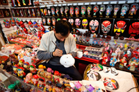 China,Beijing,The Silk Market,Artist Painting Chinese Mask - Travelasia