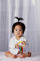 Chinese baby with pony tail,  holding toy keys - Yukmin