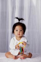 Chinese baby with pony tail,  holding toy keys - Yukmin