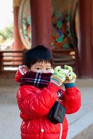 Young boy taking photo with Camera at Bulguksa Temple, Gyeongju Korea - Travelasia