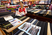 China,Beijing,The Silk Market,Tailor and Fabric Shop - Travelasia