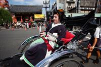 Geisha in Rickshaw in front of Asakusa Kannon Temple. Tokyo, Japan - Travelasia
