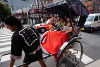 Family taking a Rickshaw ride. Japan,Tokyo,Asakusa, - Travelasia