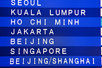 Airport departure screen with Asian cities listed. Hong Kong Airport - Travelasia