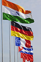 Flags of different countries blowing in the wind. - Travelasia