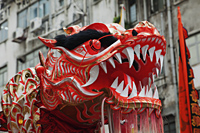 Head of dragon during traditional Dragon Dance. Tai Kok Tsui Temple Fair. Hong Kong, China - Travelasia