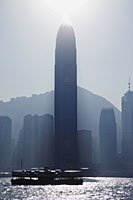 Sun burst off of International Finance Building. City Skyline and Victoria Peak, Hong Kong, China - Travelasia