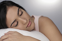 Close up of young woman sleeping on pillow - Alex Mares-Manton