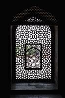Light coming through stone lattice at Humayun's Tomb. New Delhi, India - Alex Mares-Manton