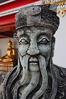 Stone Statue at Wat Pho, Bangkok, Thailand - Travelasia
