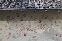 Red hand prints on side of village wall. New Delhi, India - Alex Mares-Manton