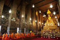 Monks Praying in the main room of Wat Pho, Bangkok, Thailand. - Travelasia