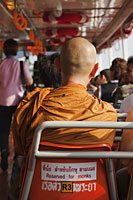 Buddhist Monk in Special Seat on Riverboat, Bangkok, Thailand - Travelasia