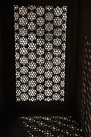 Light coming through a carved screen window . Agra, India - Alex Mares-Manton