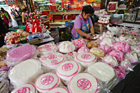 Woman preparing cakes, Chinatown, Bangkok, Thailand - Travelasia