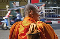 Rear view of Monk standing by side of road. Bangkok, Thailand - Travelasia
