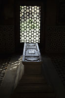 Light coming though carved stone window onto a tomb. Itmad-Ud-Daulah's Tomb, Agra, India - Alex Mares-Manton