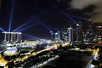 Lasers coming from the business district and Marina Bay, Singapore - Yukmin