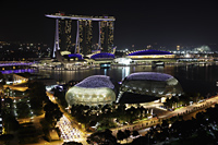 Buildings surrounding Marina Bay at night, Singapore - Yukmin