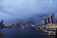 View of the buildings surrounding Marina Bay in the evening, Singapore - Yukmin