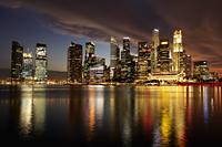 Marina Bay and city skyline reflected in the water at night, Singapore - Yukmin