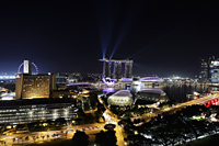 Night view of buildings surrounding Marina Bay with lasers off the Sands Casino, Singapore - Yukmin