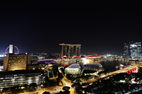 Night view of buildings surrounding Marina Bay, Singapore - Yukmin