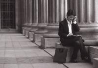 Female executive sitting, using cellular phone - Alex Microstock02