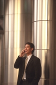 Male executive talking on cellular phone - Alex Microstock02