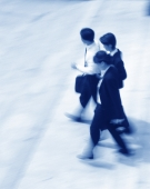 Three executives walking (motion blur), (blue tone) - Alex Mares-Manton