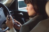 Female executive using cellular phone in car, profile - Alex Microstock02