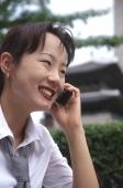 Female executive talking on cellular phone, smiling - Alex Microstock02