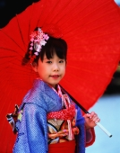 Japan, Shichi-Go-San festival, girl wearing a kimono holding an umbrella - Rex Butcher