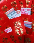 China, Hong Kong, Chinese New Year, red money packet - Rex Butcher