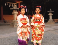 Japan, Shichi-Go-San Festival, two girls wearing  kimonos - Rex Butcher