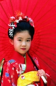 Japan, Shichi-Go-San Festival, seven year old girl with red umbrella - Rex Butcher