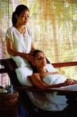 Caucasian female receiving a head massage from Asian masseuse - John McDermott