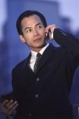 Male executive using cellular phone - Jade Lee
