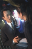 Two executives talking at night (motion blur) - Jade Lee