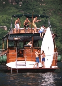 Group of teenagers on yacht , doing funny poses - Jade Lee