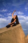Woman doing Yoga outdoors - John McDermott