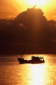 Thailand, Pattaya, Fishing boat at sunset - John McDermott