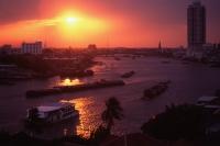 Thailand, Bangkok, Chao Praya River, Barges at sunset - John McDermott