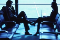 Two executives in airport lounge - Keith Brofsky