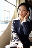 Female executive talking on cellular phone - Gareth Brown