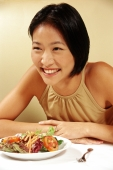 Woman at restaurant, smiling - Gareth Brown